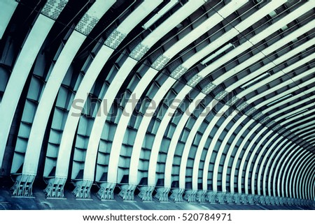 Train tunnel. Symmetric steel beams pattern. Abstract architecture, construction, transportation and travel concept