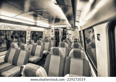 Train with empty seats. - stock photo