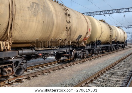 Train with oil railway cisterns on the freight station - stock photo