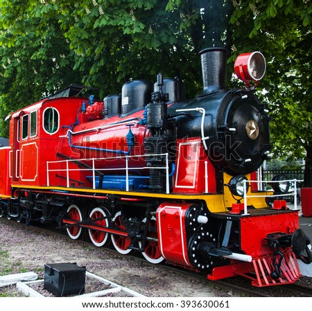 Train with steam locomotive at the station. - stock photo