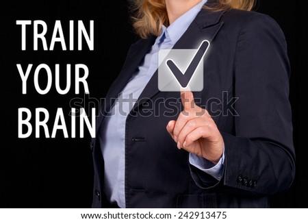 Train your Brain - Businesswoman with checkbox - stock photo