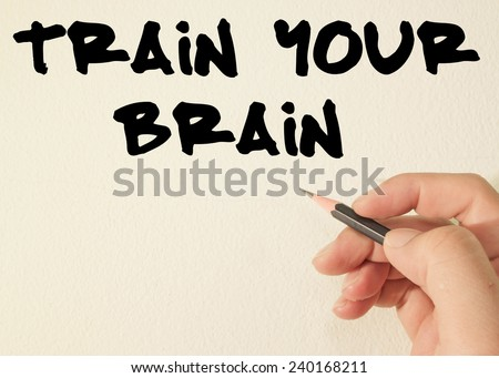 train your brain text write on wall  - stock photo