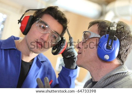 Trainer and trainee - stock photo