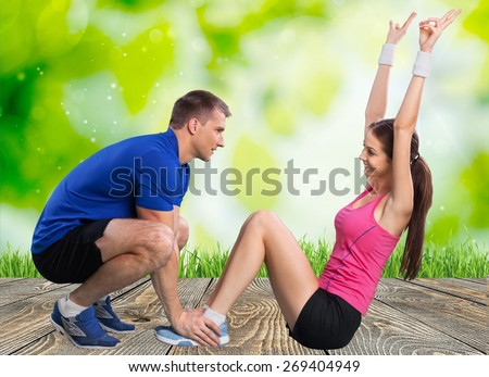 Trainer. One caucasian couple man woman personal trainer coach exercising abdominal silhouette studio isolated on white background - stock photo