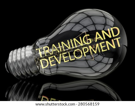 Training and Development - lightbulb on black background with text in it. 3d render illustration. - stock photo