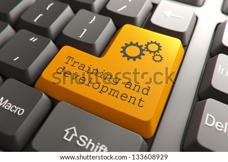 Training and Development, Orange Button on Computer Keyboard. Internet Concept. - stock photo
