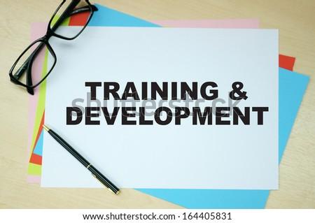 Training & Development word on paper - stock photo