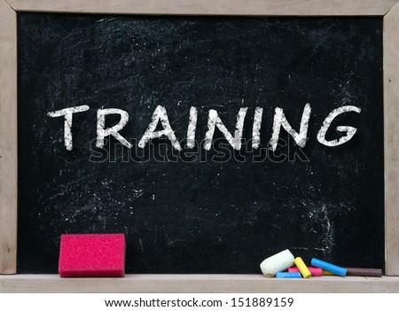 Training handwritten with white chalk on a blackboard  - stock photo