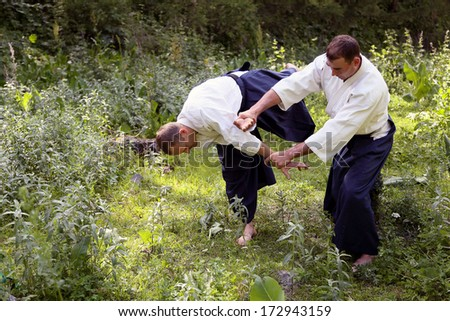 Training  martial art  Aikido. On nature. outdoors. Summer day - stock photo