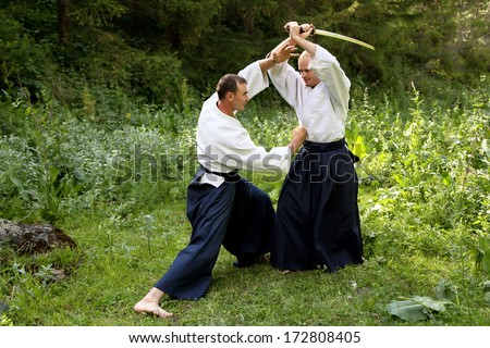 Training martial art Aikido. Outdoors. Summer day. - stock photo