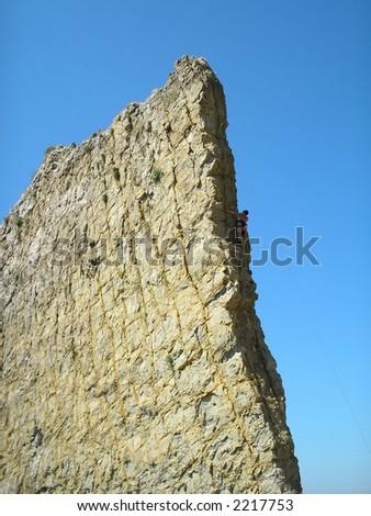 Training of rock-climbers on a narrow rock - stock photo