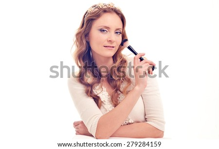 Training of the person for a make-up, the woman the makeup artist with a brush for powder - stock photo