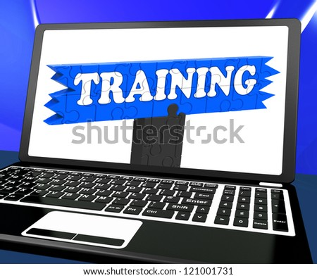 Training On Laptop Shows Coaching And Online Lessons - stock photo