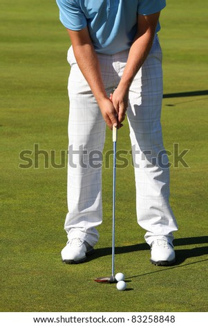 Training on putting green - stock photo