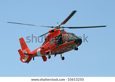 Training with the Coast Guard HH-65A Dolphin helicopter. The HH-65A is used to perform search and rescue; law enforcement, drug interdiction and military readiness. St Thomas, US Virgin Islands.