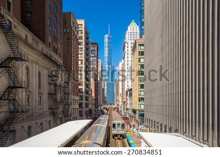 Trains in downtown Chicago IL - stock photo