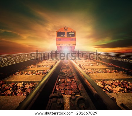 trains on junction of railways track in trains station against beautiful light of sun set sky use for land transport and logistic industry background ,backdrop,copy space theme - stock photo