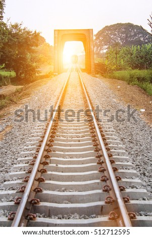 trains on junction of railways track in trains station against beautiful light of sun set sky use for land transport and logistic industry background ,backdrop,copy space theme