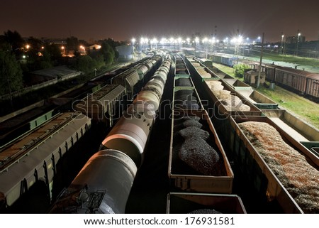 Trains shipping coal, grain and fuel oil - stock photo