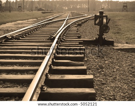 Traintracks in Auschwitz II-Birkenau concentration camp in Poland - stock photo