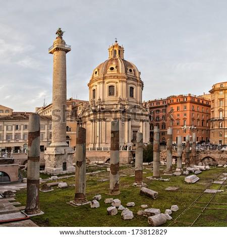 Trajans column - colonna traiana-  and Santa Maria di Loreto in Rome, Italy. Sunset. - stock photo