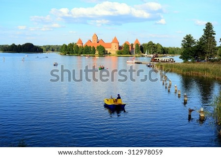 TRAKAI, LITHUANIA - AUGUST 22 : Galves lake,Trakai old red bricks castle view on August 22, 2015, Trakai, Lithuania.