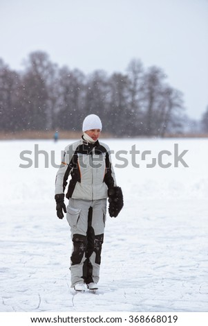 TRAKAI, LITHUANIA - JANUARY 7, 2016: Woman ice skating in winter rink. Skating involves any activity which consists of traveling on ice using skates