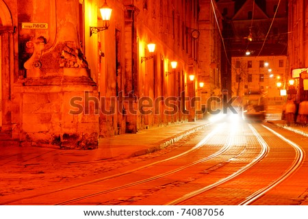 Tram lines at night  on illuminated Market Square, Lviv - stock photo