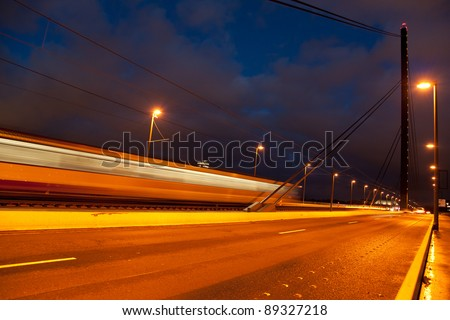 Tram moving on Oberkasseler bridge in Dusseldorf, Germany - stock photo
