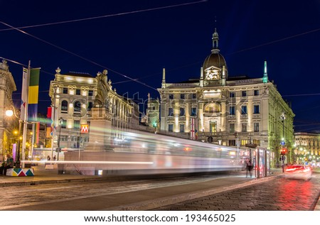 Tram passing Piazza Cordusio in Milan, Italy - stock photo