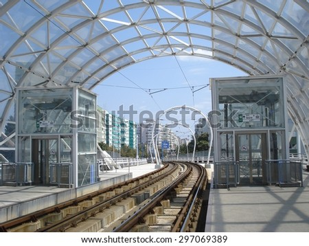 Tram rail descending from station on Basarab overpass in Bucharest - stock photo