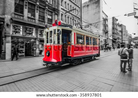 Trams passing through Istiklal street. Selective focus. Slow time shutter speed for the panning effect - stock photo