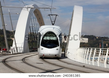 Tramway on a bridge near Confluence in Lyon, France - stock photo