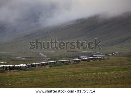 Tran-Alaska pipeline with fog near Dalton highway, Alaska - stock photo