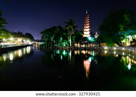 Tran Quoc pagoda at blue hour in Hanoi. This pagoda is located on a small island near the southeastern shore of West Lake. This is the oldest Buddhist temple in Hanoi, Vietnam - stock photo