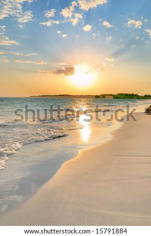 Tranquil Beach Sunset - stock photo