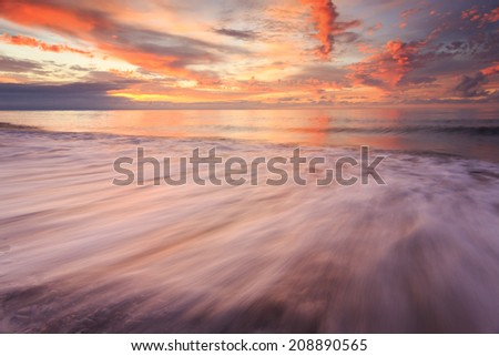 Tranquil Coastal Sunset on the Baltic sea beach in north Poland./ Tranquil Coastal Sunset on the Baltic sea beach - stock photo