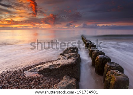 Tranquil Coastal Sunset on the Baltic sea beach. Poland coast. Pomorskie province/Tranquil Coastal Sunset - stock photo
