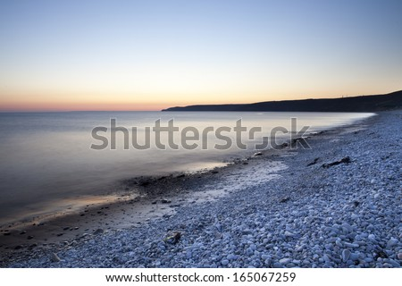 tranquil colorful ocean at night - stock photo