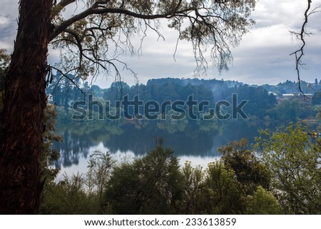 Tranquil Daylesford Lake after spring rain, Australia. - stock photo