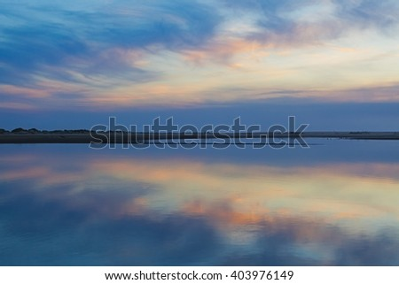 Tranquil dusk time with pastel colored sky reflectin in the sea waters, Australia. - stock photo