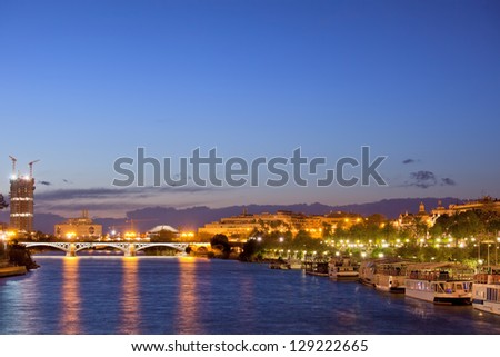 Tranquil evening in the City of Seville by the Guadalquivir river in Spain.