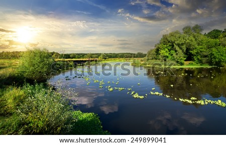 Tranquil evening on a river in summer - stock photo