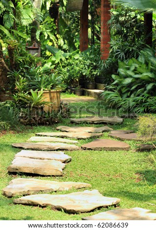 tranquil garden. selective focus on the stone path - stock photo