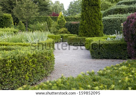 Tranquil Garden Walk - stock photo