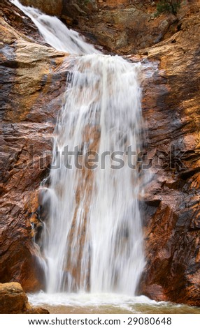 Tranquil image of the beautiful Bridal Veil Falls waterfall at Seven Falls in Colorado Springs, Colorado (slow shutter speed effect). - stock photo