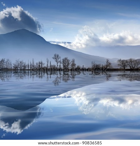 Tranquil mountain landscape with a lake - stock photo