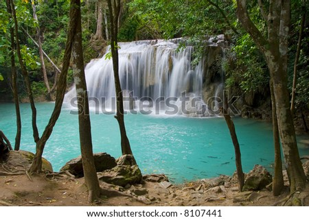 Tranquil place by the waterfall in Kanchanaburi province, Thailand. - stock photo