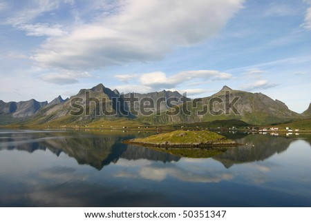 Tranquil scene and reflections in Norwegian Fjord - stock photo