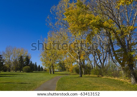 Tranquil scene of a golf course in the season of Autumn